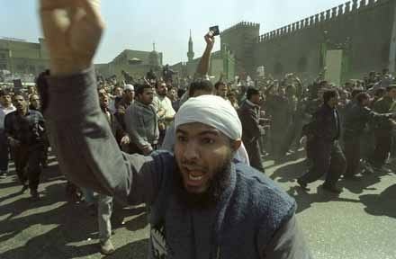 An Egyptian Islamist waves his fist in the air after Friday prayers at Al Azhar Mosque. 4th of March 1994. Ph. Norbert Schiller