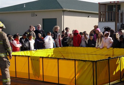 Earl Hanson students get to see how a Fol-Da-Tank is used.