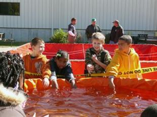Not even the yellow Fire Line Do Not Cross tape could stop the students temptation of playing in the water.