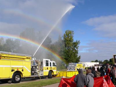 Andalusia Fire Department demonstrates how they put out fires using their deluge nozzle on top of the pumper truck. The students from Earl Hanson got an added bonus as two rainbows appear during the demonstration.