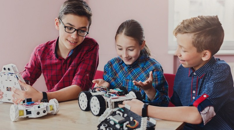 Children creating robots at school, stem education, copy space. Early development, diy, innovation, modern technology concept