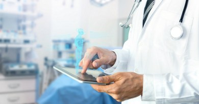 Smart health care internet of things and hospital automation management , Artificial intelligence hologram robot adviser technology concept. Doctor with Stethoscope using tablet for remote monitoring.