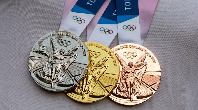 April 17, 2021 Tokyo, Japan. Gold, silver and bronze medals of the XXXII Summer Olympic Games in Tokyo on the chest of the athlete.