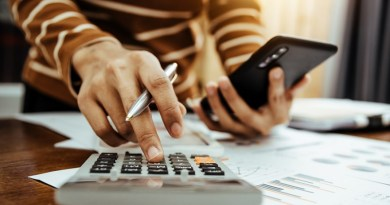 Female accountant or banker making calculation of finance and economy banking concept.