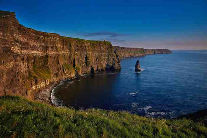 visit the cliffs of moher at sunset on your ireland road trip