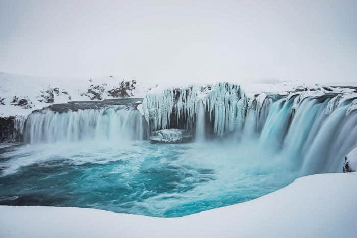 visiting Godafoss waterfall is one of the Things To Do In Iceland In Winter