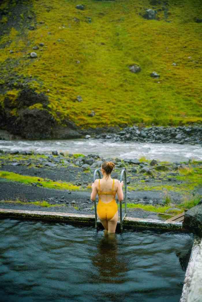 Swimming in Seljavallalaug hot springs in Iceland | Iceland hot spring Seljavallalaug swimming pool