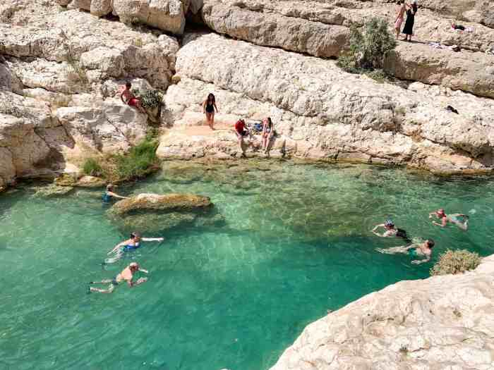 People swimming in Wadi Shab
