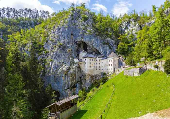 visit the world largest cave castle Predjama Castle for a change of pace when visiting castles in Europe