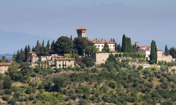 Castello di Vicchiomaggio with several of its outer building on a hilltop displaying just one of the beautiful Castles in Tuscany