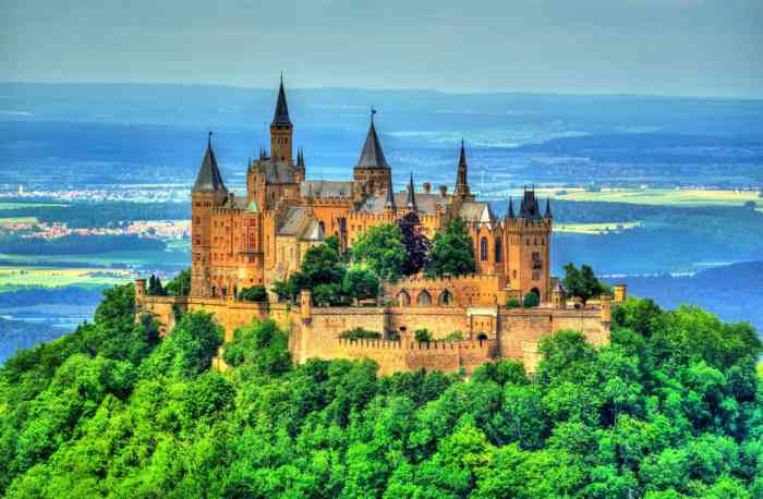 Castles in Germany like Hohenzollern Castle are surrounded by trees in the Swabian Alps