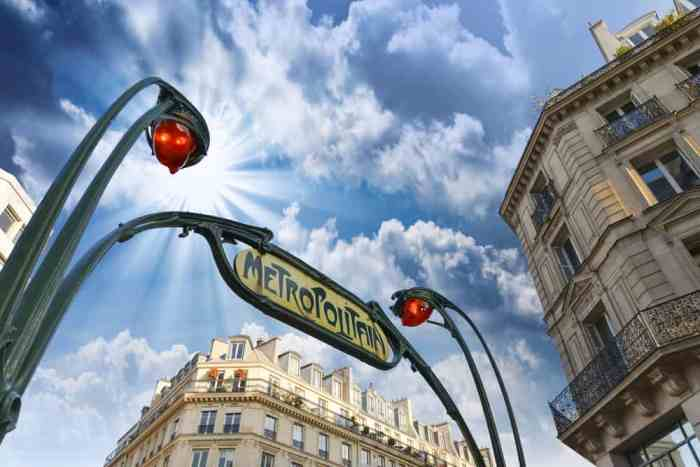 Paris metro station entrance sign with blue sky