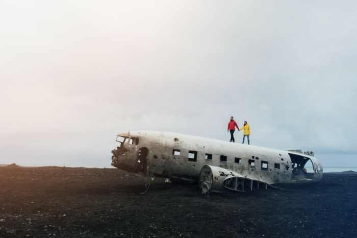 people walking on top of the Iceland plane crash