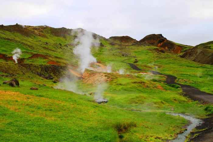 steam filling the valley on the way to Reykjadalur Hot Springs