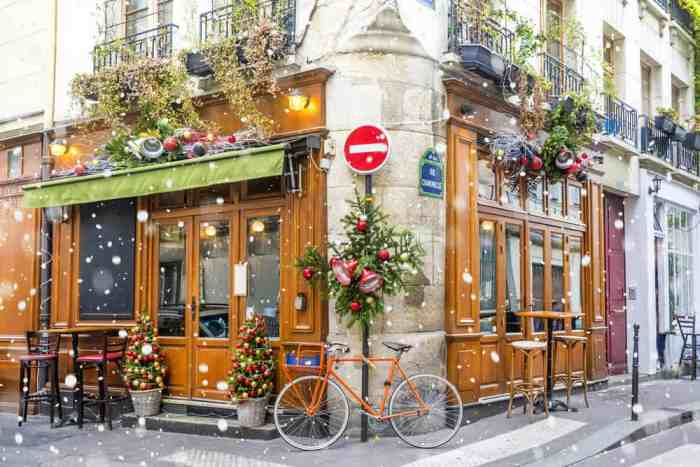 Visit a decorated cafe during christmas in paris