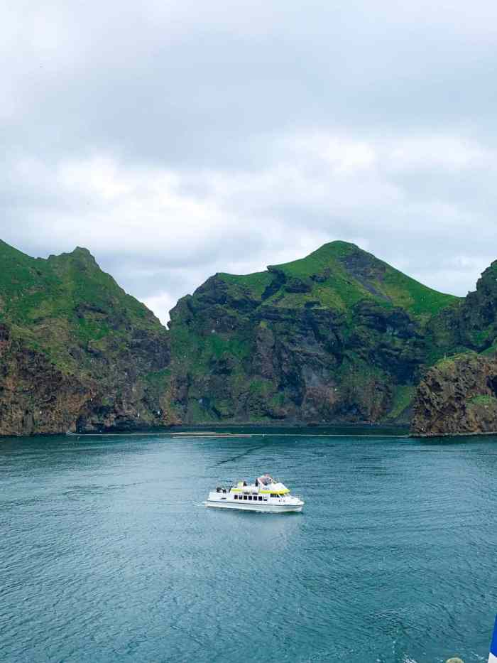 boat in the bay of the capital of the westman islands