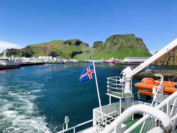 Icelandic flag flying as westman islands ferry leaves port