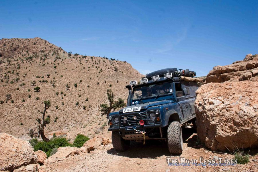 Land Rover edged around a boulder in the High Atlas Mountains