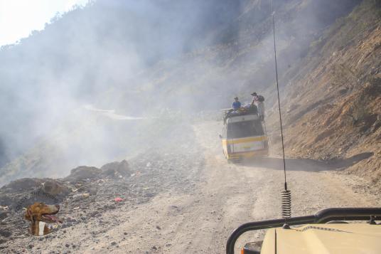Dust dirt roads stuck behind a collectivo