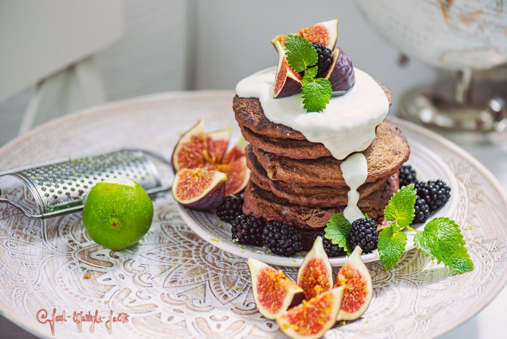 Vegan foodporn at its best: Delicious vegan pancakes topped with soy yoghurt and fruits