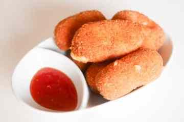 Geitenkaaskroketjes met pancetta | Foodaholic.nl