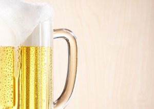 Lager beer on wooden background, studio shot