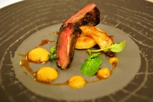Pan roasted breast of wood pigeon with burnt orange purée, smoked apple, sage fondant potato, watercress