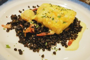 Grilled cod rarebit with cauliflower purée, puy lentils, bacon vinaigrette