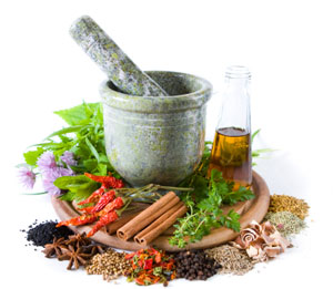 pic of raw organic healthy foods with a pestle and mortar