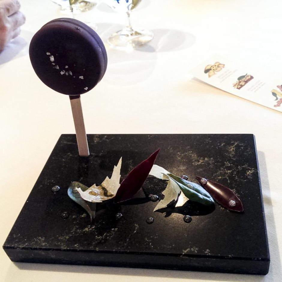 Sant Pau black truffle 'ice cream' lollipop with chocolate leaves and truffle 'dew'