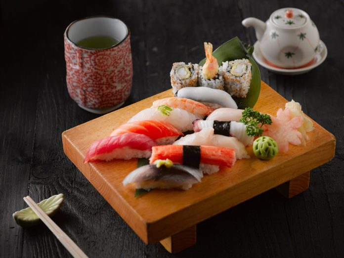 sushi on brown wooden board 2098085