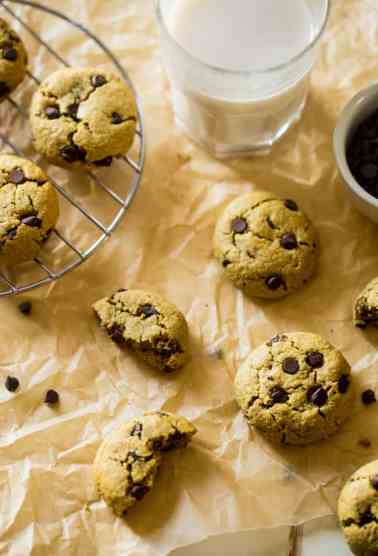 Easy Healthy Gluten Free Chocolate Chip Cookies - SO big, soft and chewy that you would never believe they are butter and oil free and use a secret, heart-healthy ingredient to make them low fat and only 105 calories! | Foodfaithfitness.com | @FoodFaithFit