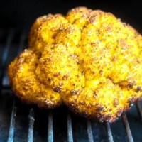 """What It Takes"" Smoked Whole Yellow Cauliflower with Jerk Spice"
