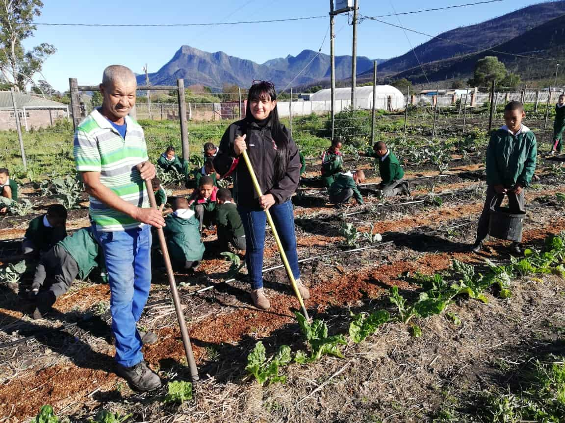 Johan Hus Primary school caretaker Georgie Botha (left) and principal Desiree Mey (right), with the school learners tending to the garden.