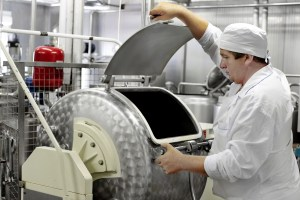 Modern Dairy food-processing industry Worker On A Milk Factory