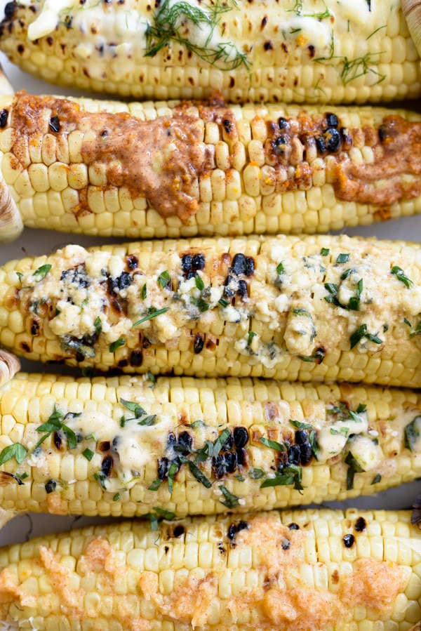 ears of grilled corn with butter