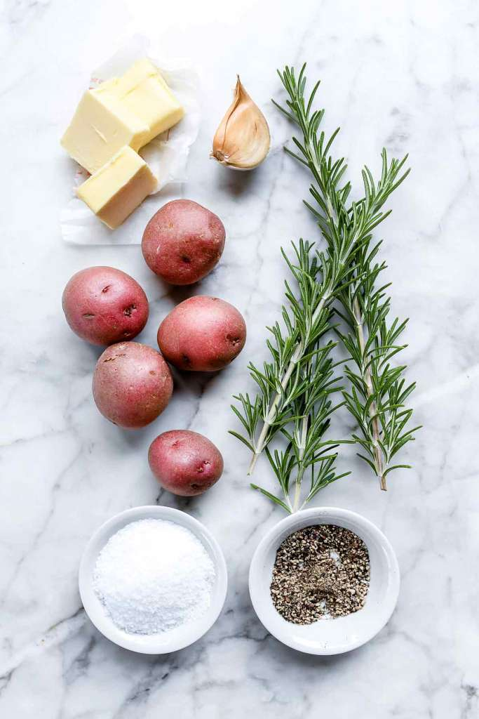 smashed potatoes ingredients on marble countertop