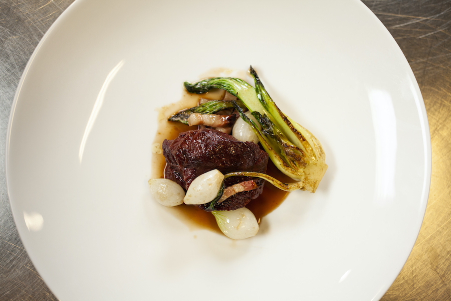 Yorkshire shin of beef, Alsace bacon, baby onions & pak choi.