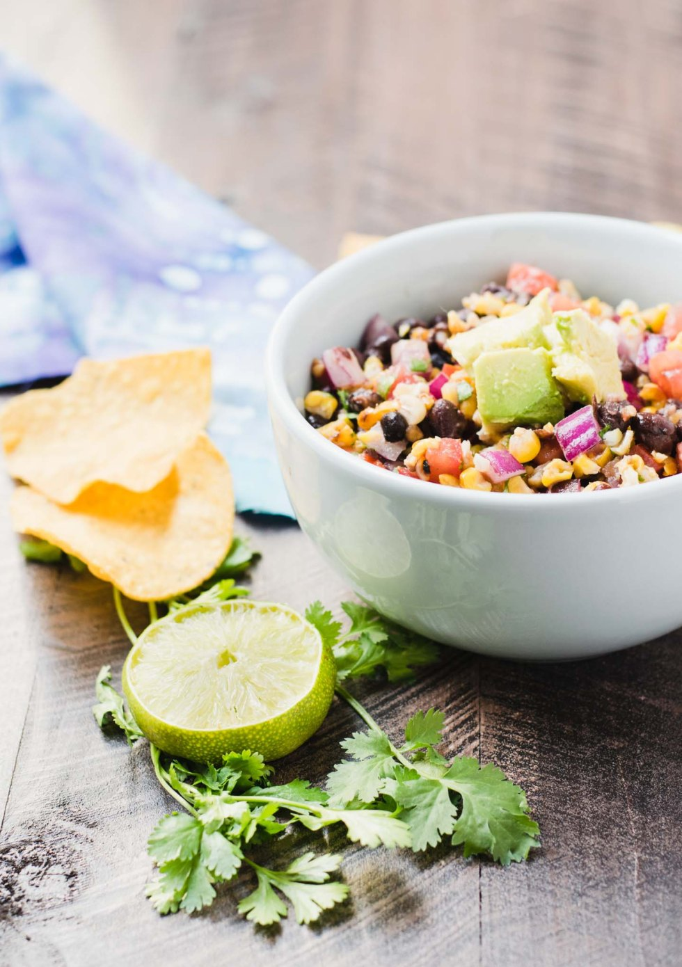 This grilled corn and black bean salsa is the perfect dip for a summer party.