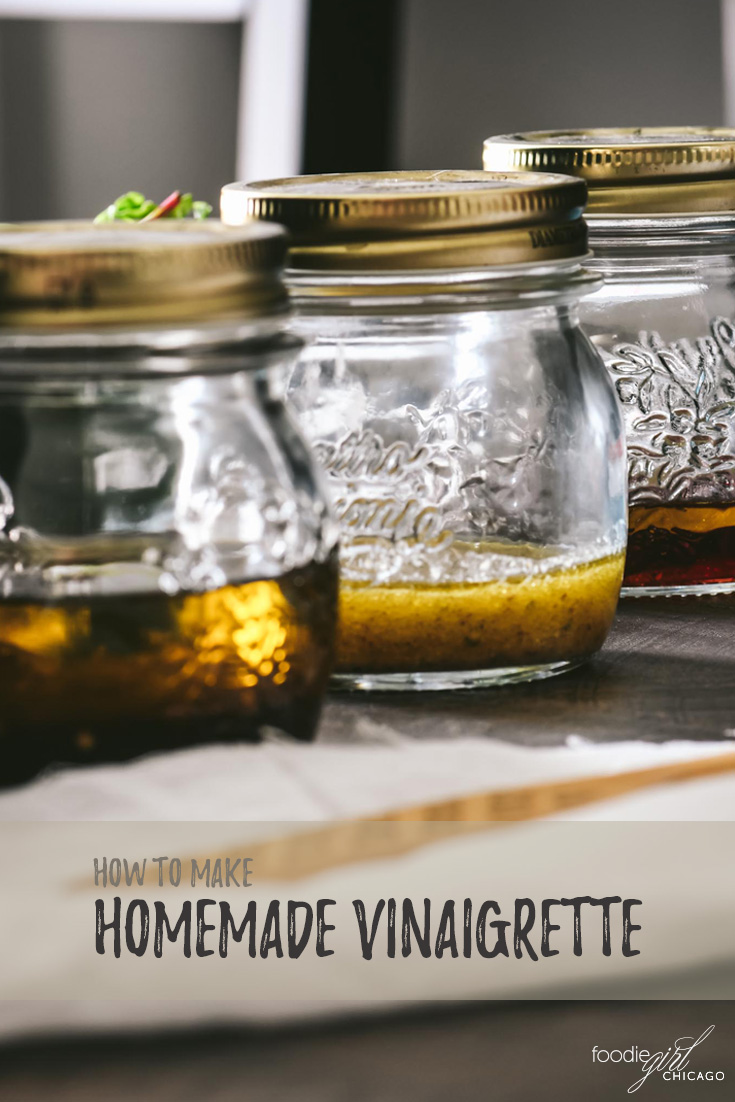 Three mason jars filled with homemade vinaigrette