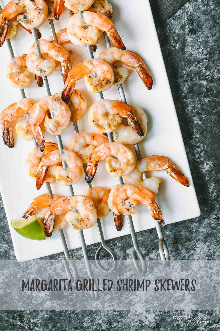 Grilled shrimp skewers on a white tray