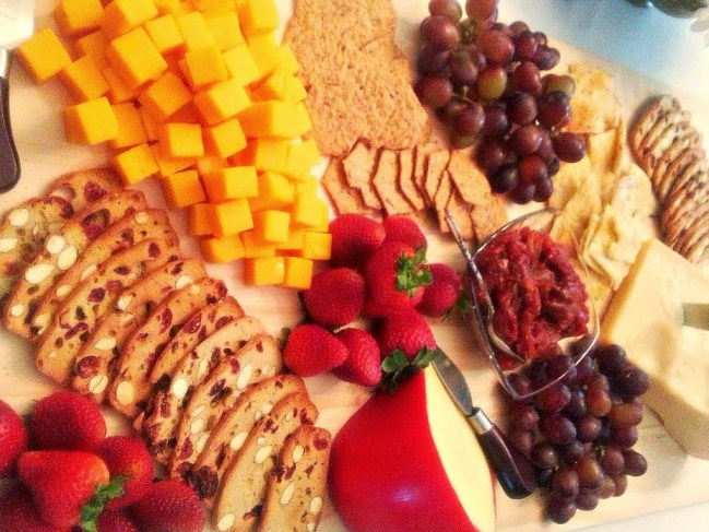 Assorted cheeses, homemade tomato chutney, crackers and fruit