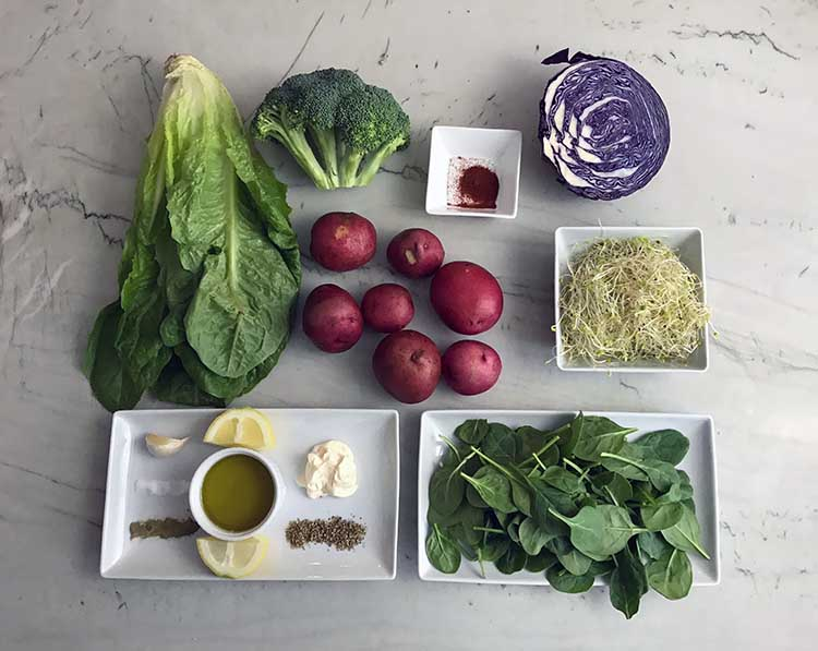 Ingredients for a roasted potato and greens salad.