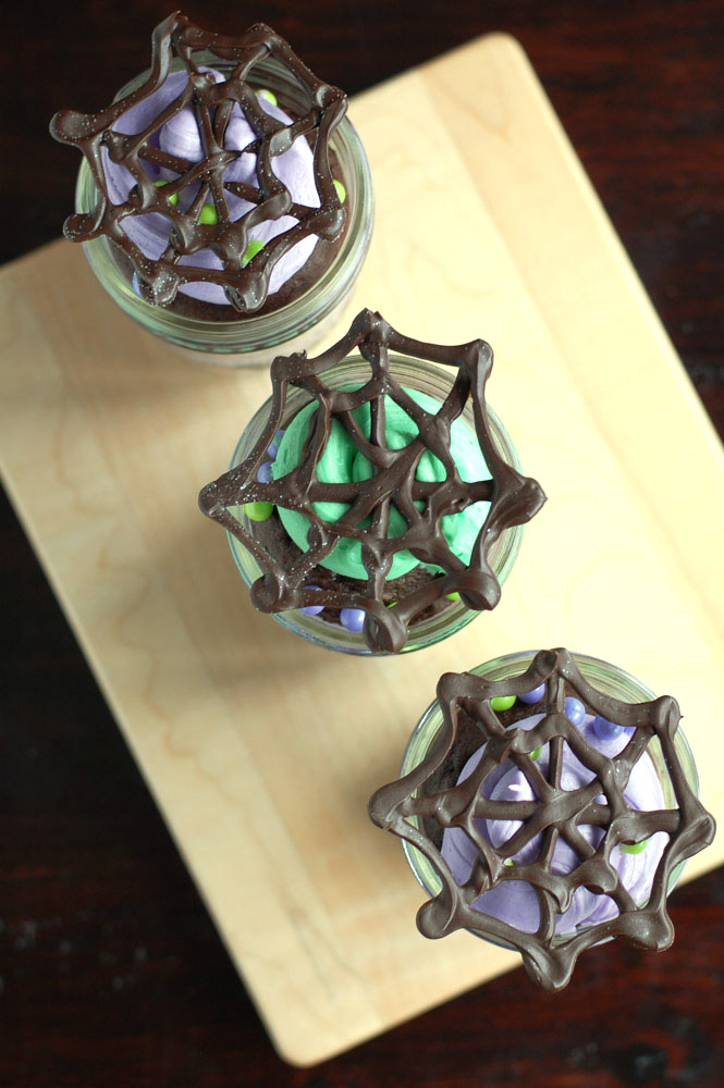 Halloween Mason Jar Cakes with chocolate spider web toppers make a cute treat for your next Halloween party.