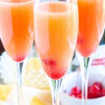 Glass with mimosas and cherries.