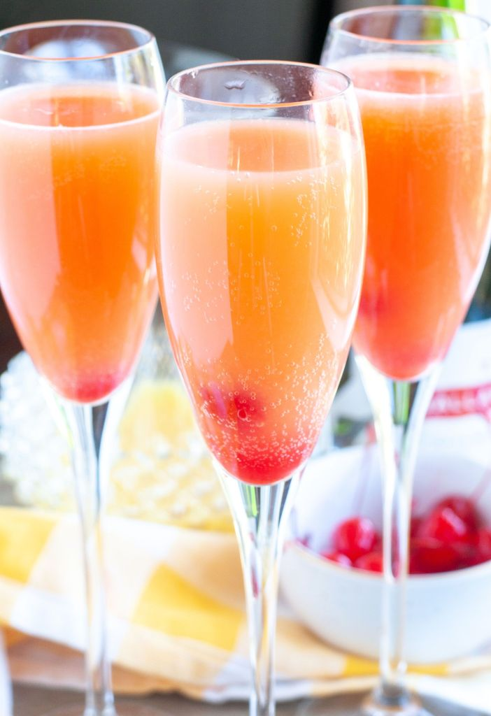 3 glasses of blushing mimosas with cherries