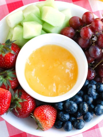 Fruit platter with orange dip.