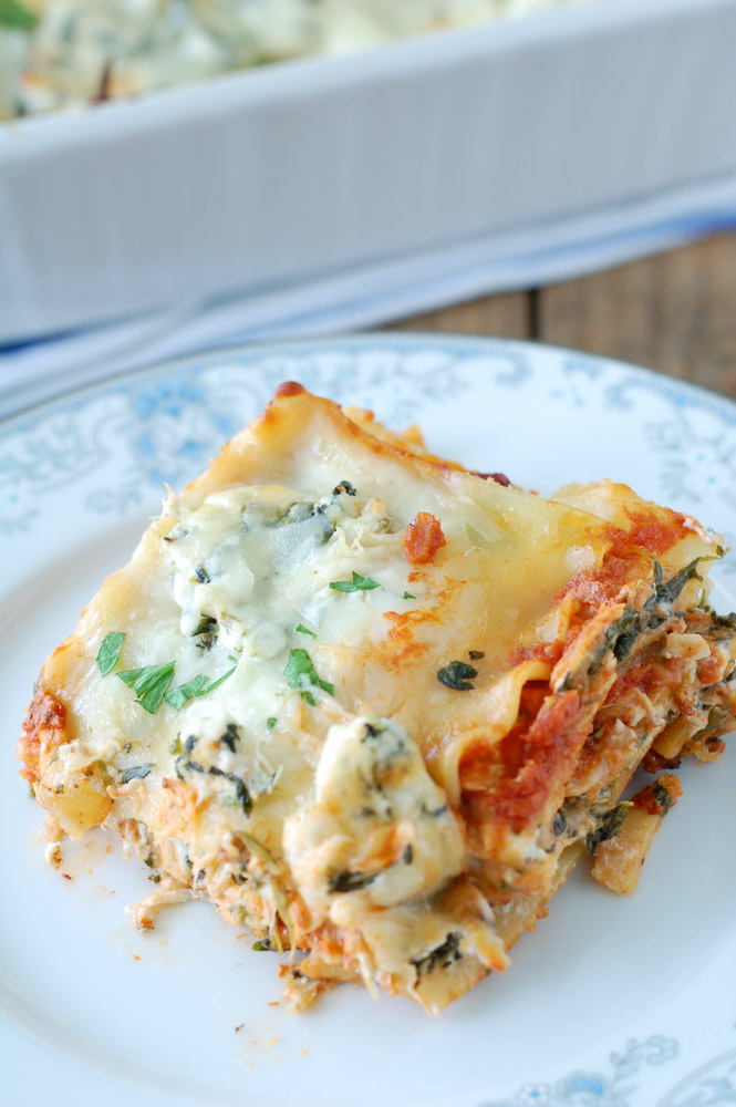 This easy chicken lasagna has amazing homestyle flavor and can be assembled quickly by using a few shortcuts. Rotisserie chicken, thick and hearty tomato sauce, spinach and cheese make a delicious lasagna your whole family will love.