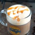 Mug of coffee with cream and caramel.