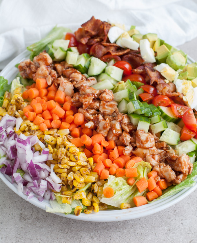 bbq chicken cobb salad with eggs, bacon and vegetables
